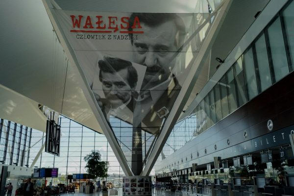 "Billboard presenting actor Robert Wieckiewicz playing Lech Walesa in the movie ""Wałęsa – Man of Hope"" at the Gdansk Lech Walesa Airport"