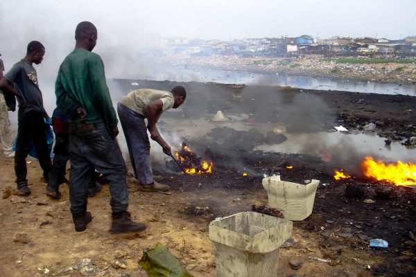 Young boys are burning cables from computers; mobile phones or TV sets in order to retrieve copper from them for sale. Their t-shirts are black from the dirty smoke. None of them wear protective clothes. They are exposed to jeopardous mix of different heavy metals and compounds of fluorine and chlorine, leading to deadly diseases of lungs, eyes, heart or bronchitis.