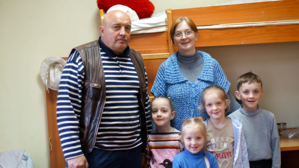 Jurij Radczenko, his wife Natalia and four children, have been sharing one room at a church shelter for the past nine months.