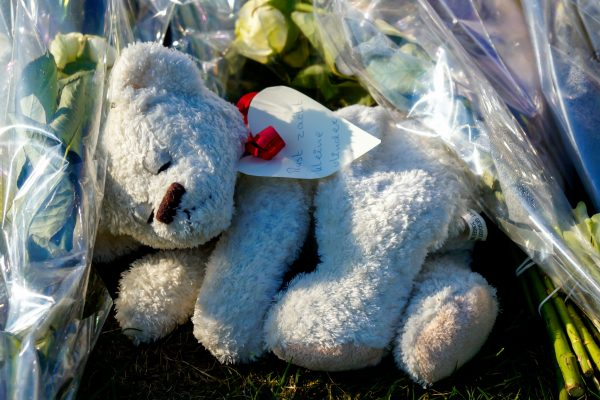 July 23, 2014: Eindhoven, Military Airport. Mourners left flowers and teddy bears to pay tribute to victims of the plane crash.